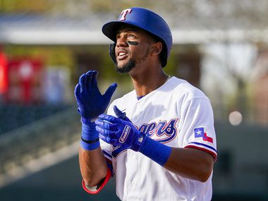 Texas Rangers outfielder Leody Taveras celebrates after reaching on a single during the eighth inning of a spring training game against the Chicago Cubs at Surprise Stadium on Thursday, Feb. 27, 2020, in Surprise, Ariz.