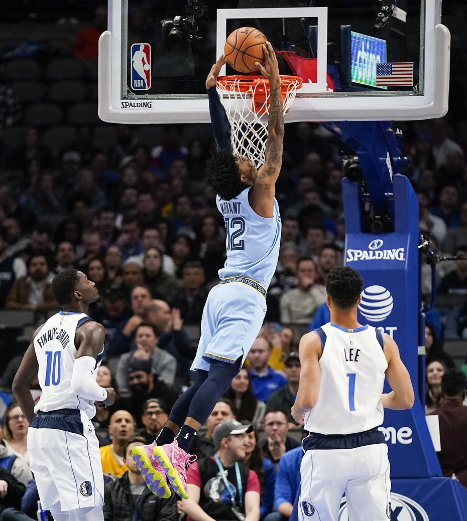 Memphis Grizzlies guard Ja Morant (12) dunks the ball past Dallas Mavericks forward Dorian Finney-Smith (10) and guard Courtney Lee (1) during the second half of an NBA basketball game at American Airlines Center on Wednesday, Feb. 5, 2020, in Dallas.