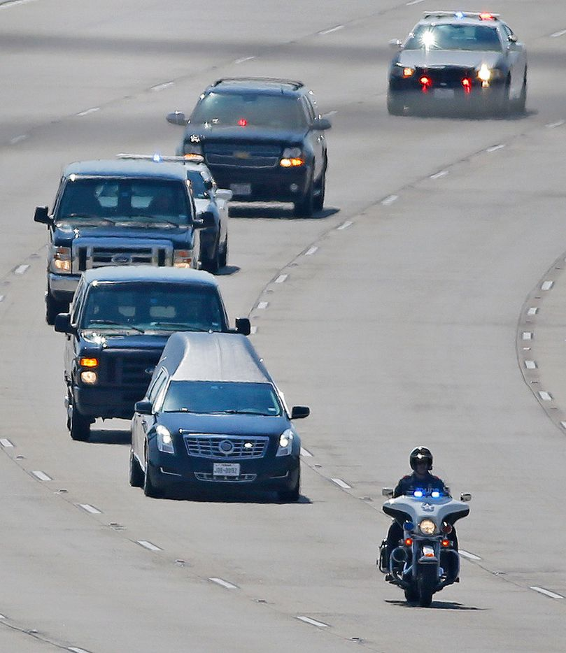 "A hearse containing the body of Dallas Police Department Sr. Cpl Earl ""Jamie"" Givens is escorted along the George W.Bush Tollway to Prestonwood Baptist Church in Plano on Wednesday, July 25, 2018. (Louis DeLuca/The Dallas Morning News)"