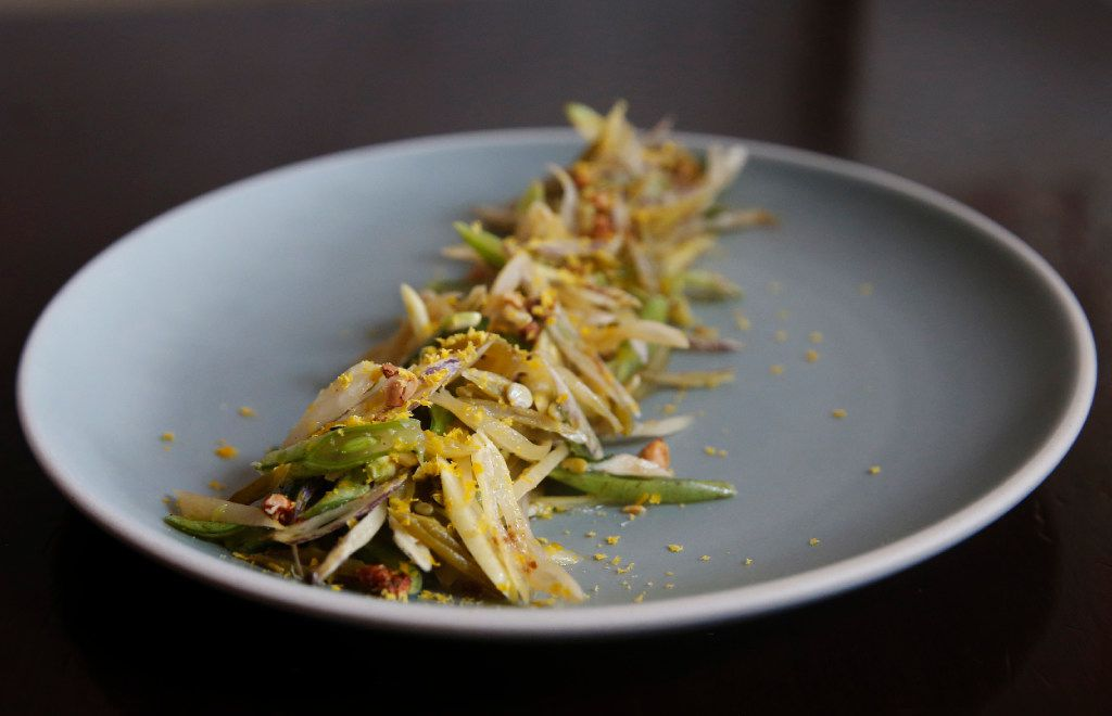 Wax beans with herbs, spicy peanuts, salted fish and dried egg yolks (Tailyr Irvine/The Dallas Morning News)