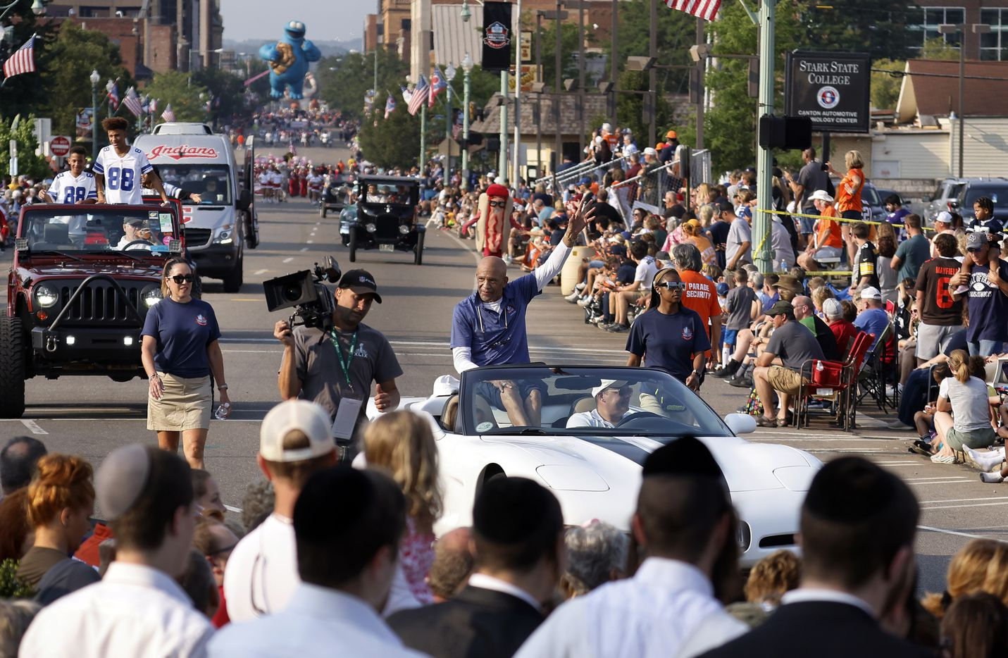 Dallas Cowboys Pro Football Hall of Fame inductee Drew Pearson waves to fans along the Canton Repository Grand Parade route in downtown Canton, Ohio, Saturday, August 7, 2021. Family members of his rode behind him in the parade honoring newly elected and former members of the Hall, including newcomers and former Dallas Cowboys players Cliff Harris, Drew Pearson and head coach Jimmy Johnson. (Tom Fox/The Dallas Morning News)