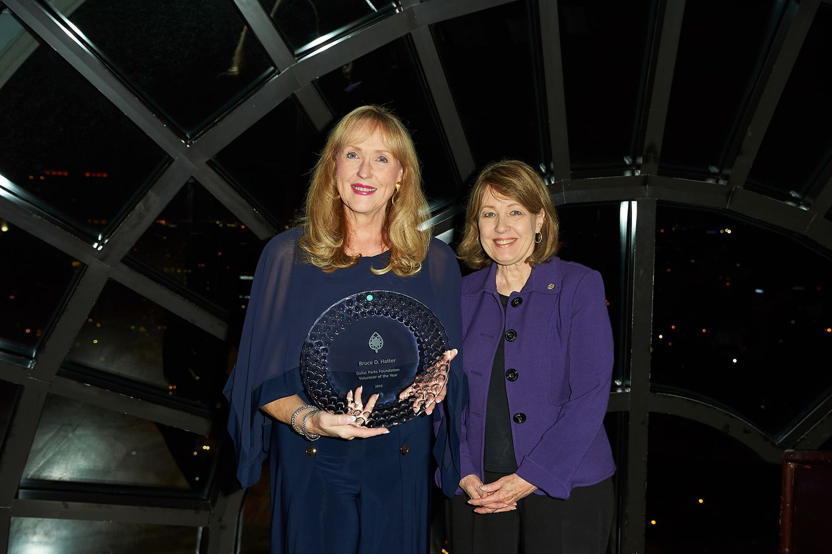 Dallas City Council member Sandy Greyson (right) worked with Betti Coffey and her late husband Bruce Hatter to create a new city park. Here, Coffey holds her husband's Volunteer of the Year award.