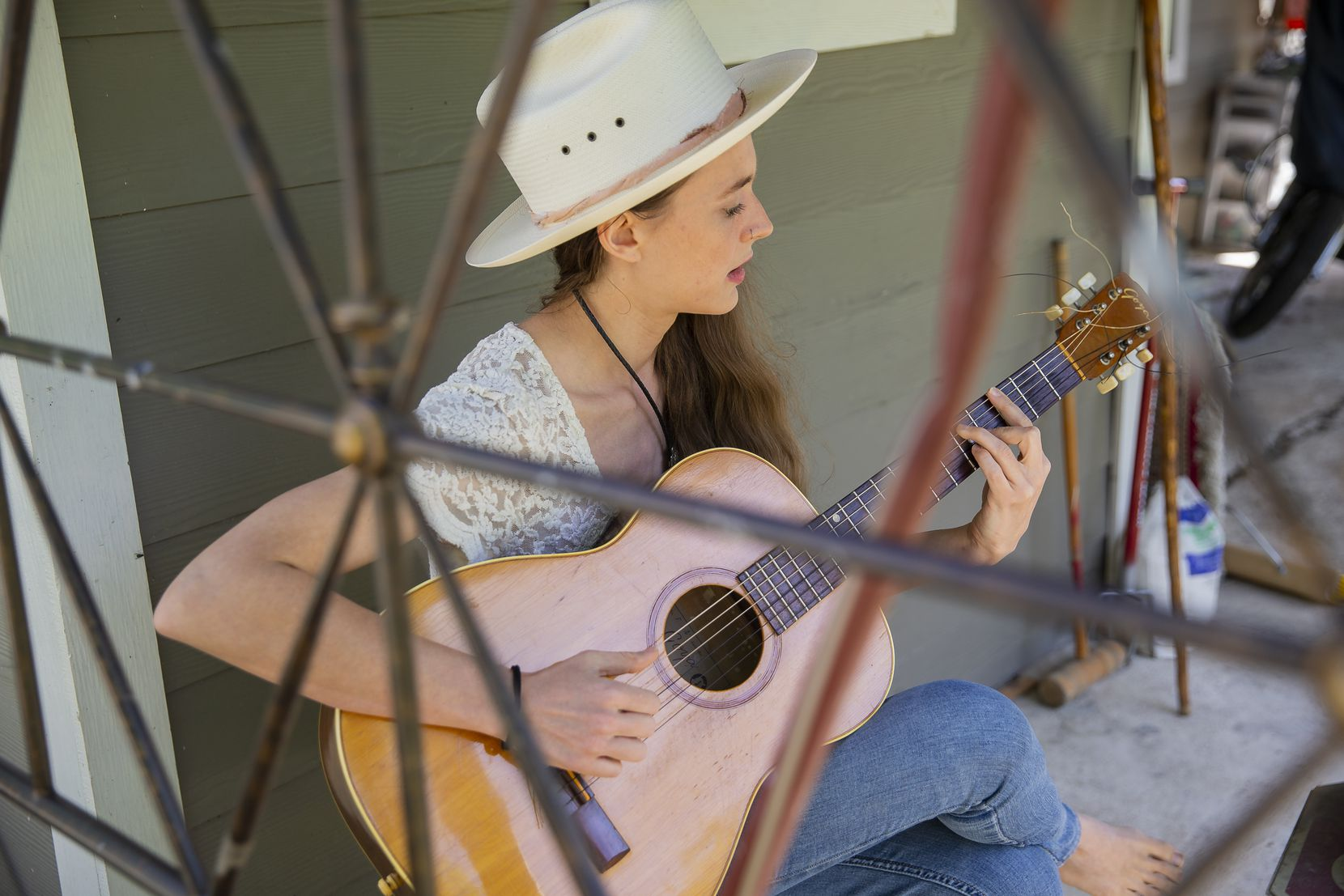 Musician and yoga instructor Jenna Clark plays guitar in the backyard of her Oak Cliff home. Clark lost her job as a result of the coronavirus pandemic.