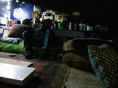 Spencer Cardwell took a moment on his couch at his encampment during the annual homeless count in Dallas on Jan. 24.