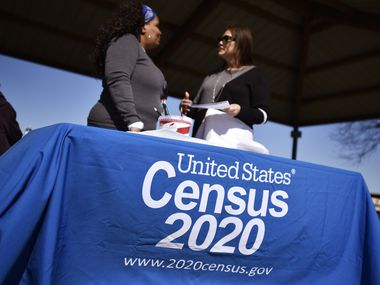 Rita Williams, left, a partnership specialist with the U.S. Census Bureau, speaks with Minerva Rodriguez, right, who heps with census community outreach for Dallas County, during Census Fun Day at Jaycee Zaragoza Park Pavilion in Dallas, Feb. 08, 2020.