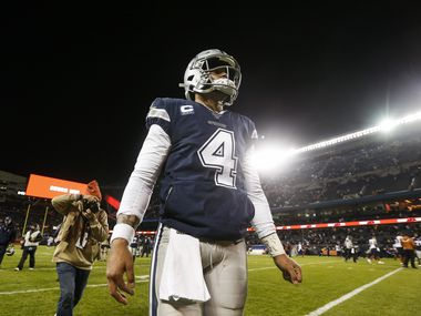 FILE - Cowboys quarterback Dak Prescott (4) walks off the field following a 31-24 loss to the Bears on Thursday, Dec. 5, 2019, at Soldier Field in Chicago.