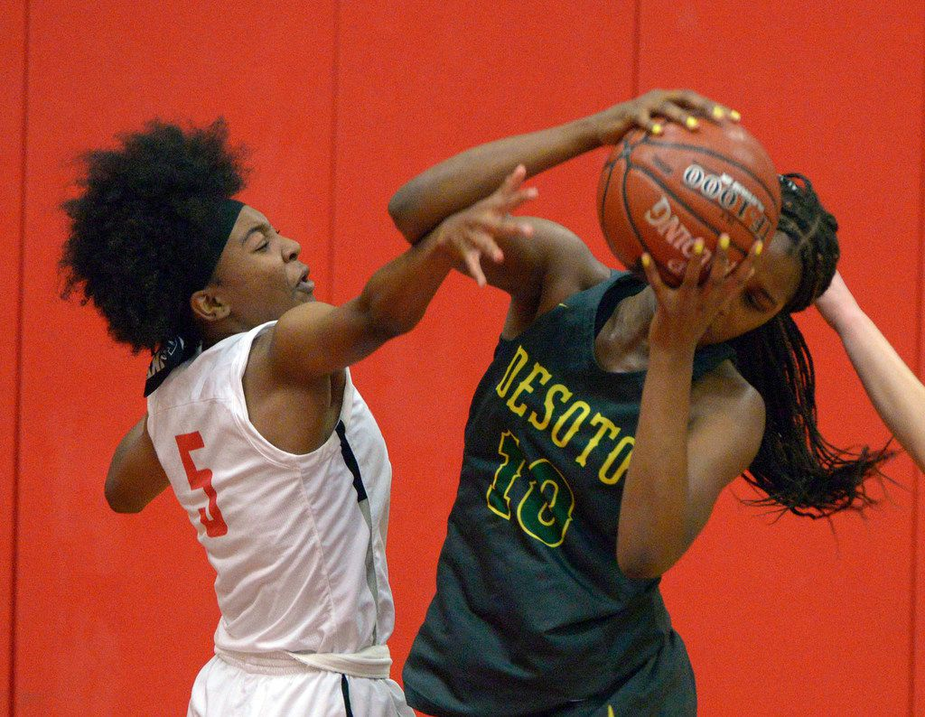 Frisco Zoe Junior (5) goes after the rebound with DeSoto's Ayanna Thompson (10) in the second half during a girls high school basketball game between DeSoto and Frisco Liberty, Tuesday, Nov. 26, 2019, in Frisco, Texas. (Matt Strasen/Special Contributor)