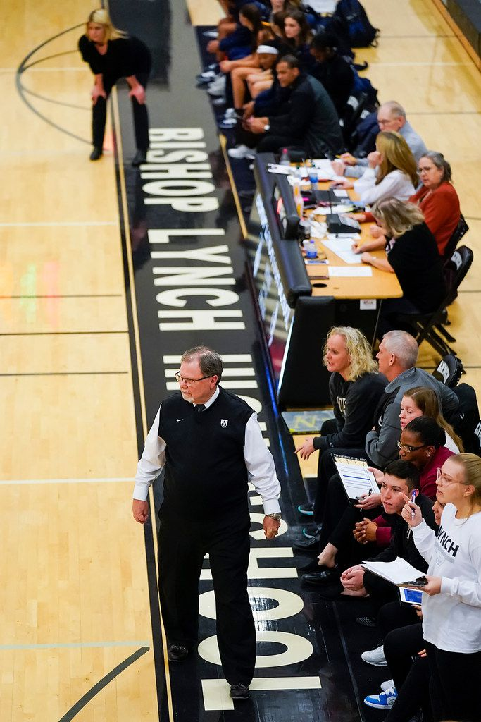 Bishop Lynch head coach Andy Zihlman (bottom) and Prestonwood Christian head coach Holly Mulligan work the sidelines during a TAPPS 2-6A high school girls basketball game on Friday, Feb. 7, 2020, in Dallas. Bishop Lynch won the game 59-54. (Smiley N. Pool/The Dallas Morning News)