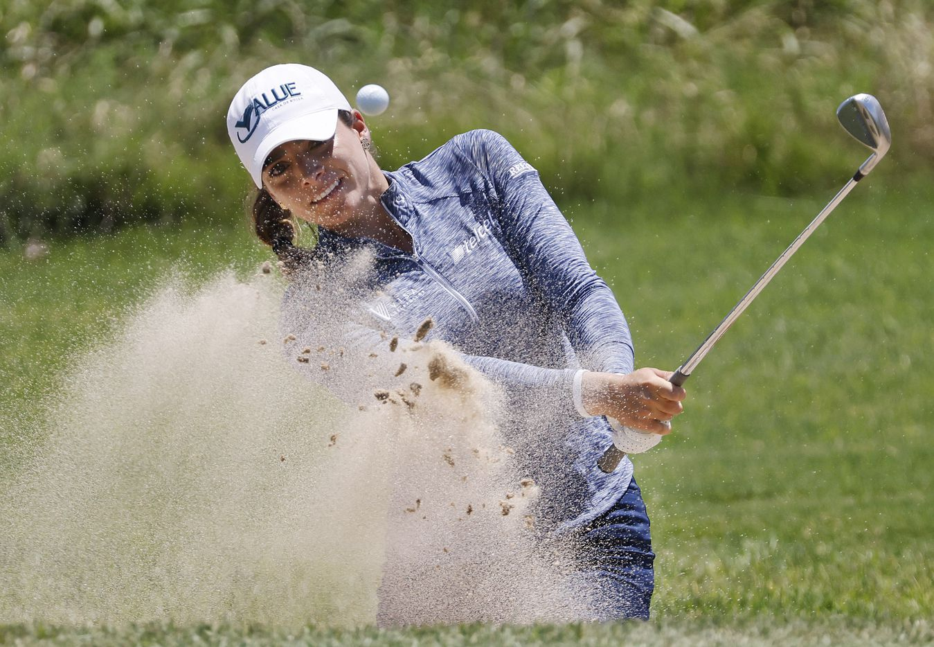 Professional golfer Gaby Lopez fires a shot out of the No. 9 green side bunker during the opening round of the LPGA VOA Classic at the Old American Golf Club in The Colony, Texas, Thursday, July 1, 2021. (Tom Fox/The Dallas Morning News)