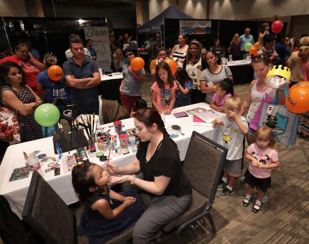 Community members visit various activity booths during a health fair hosted by the Holistic Festival of Lights at Plano Event Center in Plano, TX, on July 22, 2018. (Jason Janik/Special Contributor)