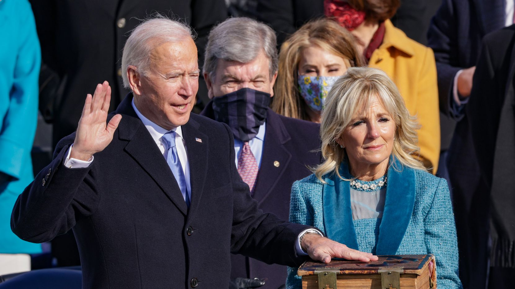 Joe Biden is sworn in as the nation's 46th president on the West Front of the U.S. Capitol on January 20, 2021, with first lady Dr. Jill Biden holding the Bible.