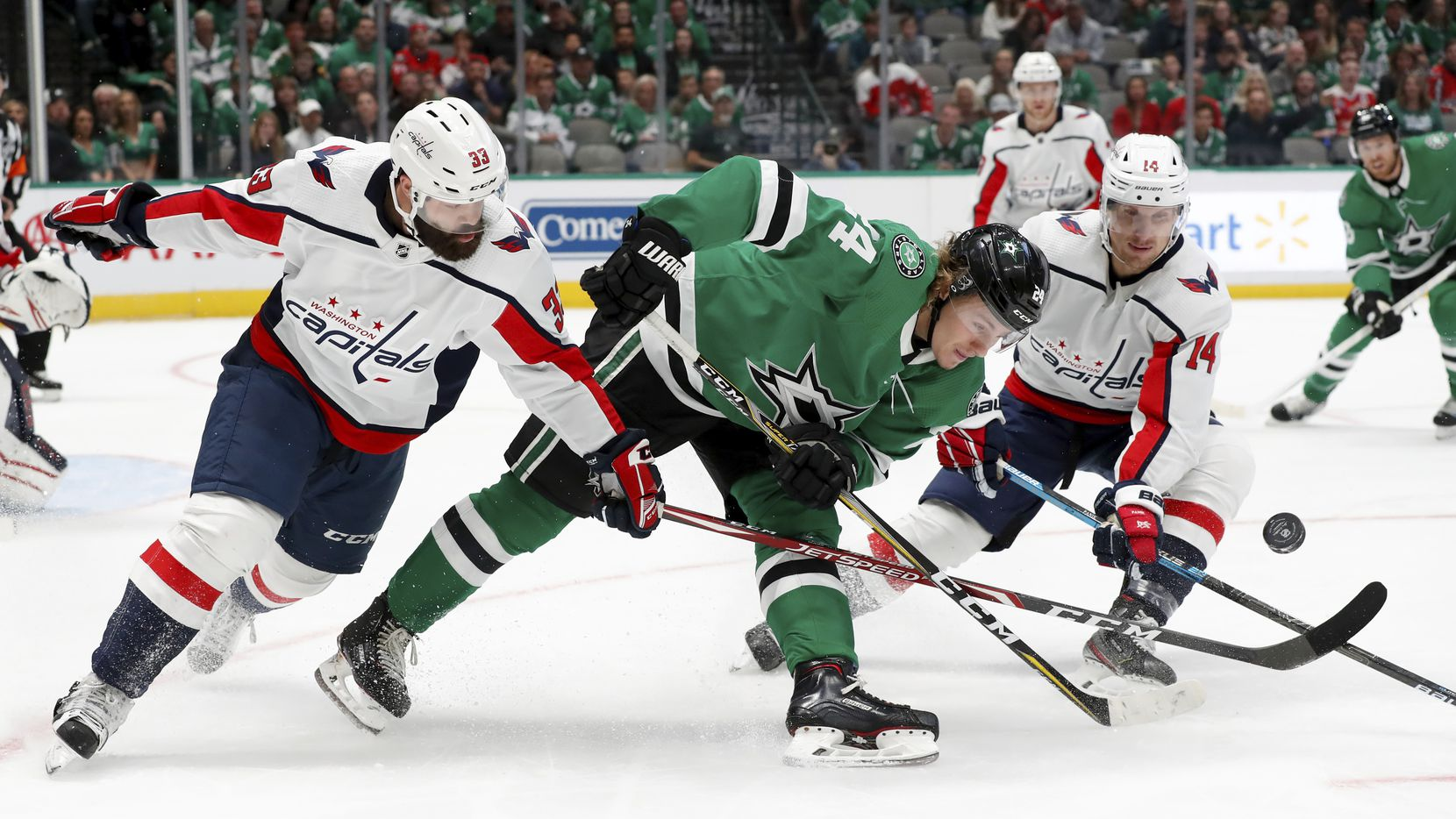 Washington Capitals defenseman Radko Gudas (33) and right wing Richard Panik (14) combine to strip the puck away from Dallas Stars left wing Roope Hintz (24) in the first period of an NHL hockey game in Dallas, Saturday, Oct. 12, 2019.