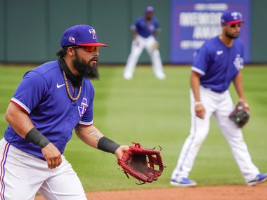 Texas Rangers third baseman Rougned Odor takes a defensive stance as shortstop Isiah Kiner-Falefa (right) does the same during the fourth inning of a spring training game against the Los Angeles Dodgers at Surprise Stadium on Sunday, March 7, 2021, in Surprise, Ariz.