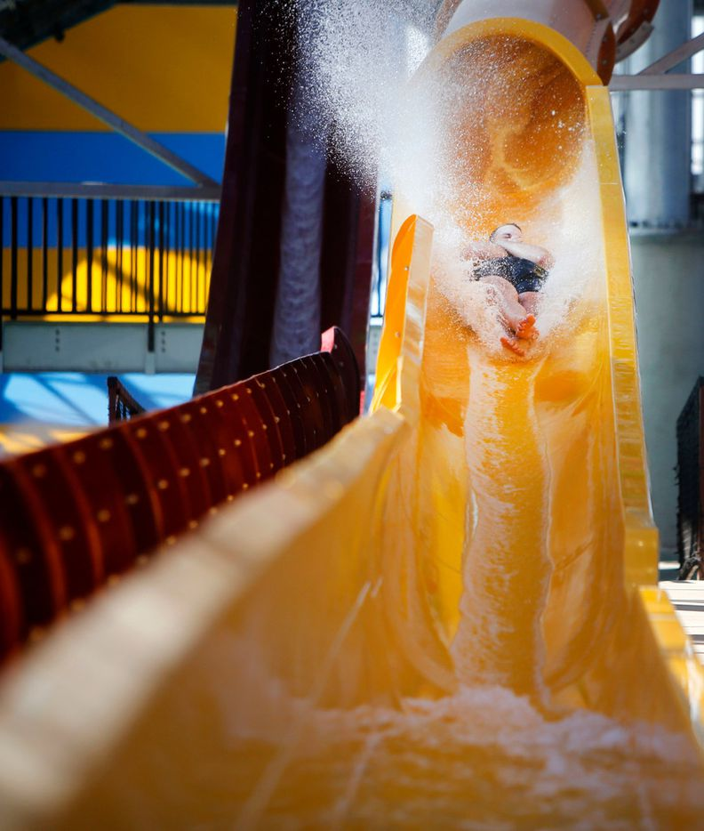 Tyler Hebert goes down a water slide during a media day at the new Epic Waters Indoor Waterpark in Grand Prairie, Texas on Monday, Jan. 8, 2018. The city-owned waterpark is the largest in North America under a single retractable roof. (Rose Baca/The Dallas Morning News)