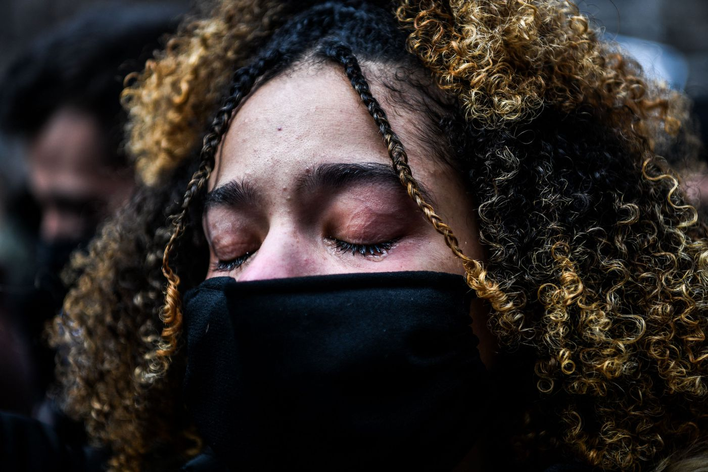 A woman cries as the verdict is announced in the trial of former police officer Derek Chauvin outside the Hennepin County Government Center in Minneapolis, Minnesota on April 20, 2021. - Sacked police officer Derek Chauvin was convicted of murder and manslaughter on April 20 in the death of African-American George Floyd in a case that roiled the United States for almost a year, laying bare deep racial divisions.