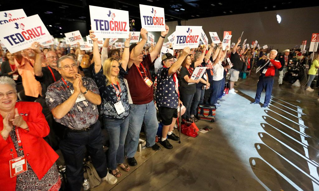 Supporters hold signs and cheer as U.S. Sen. Ted Cruz takes the stage at the Texas GOP Convention.