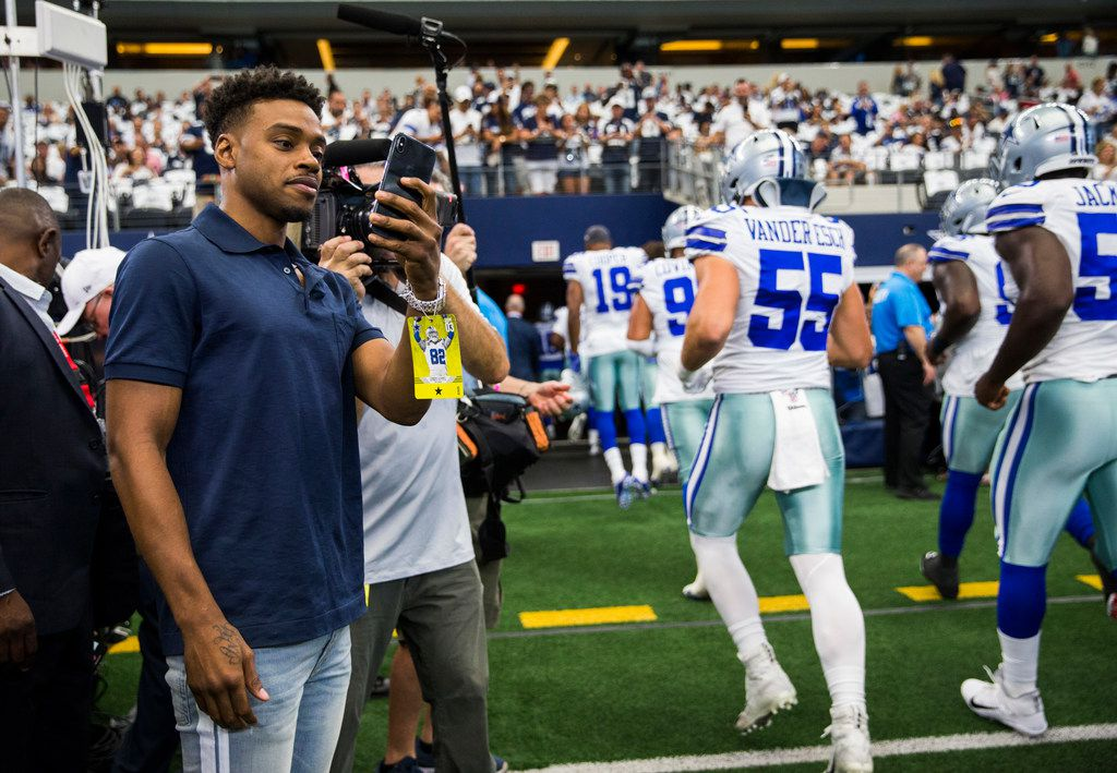 Boxer Errol Spence Jr. watches as the Cowboys leave the field after warmups before an NFL game between the New York Giants and Dallas Cowboys on Sunday, September 8, 2019 at AT&T Stadium in Arlington.