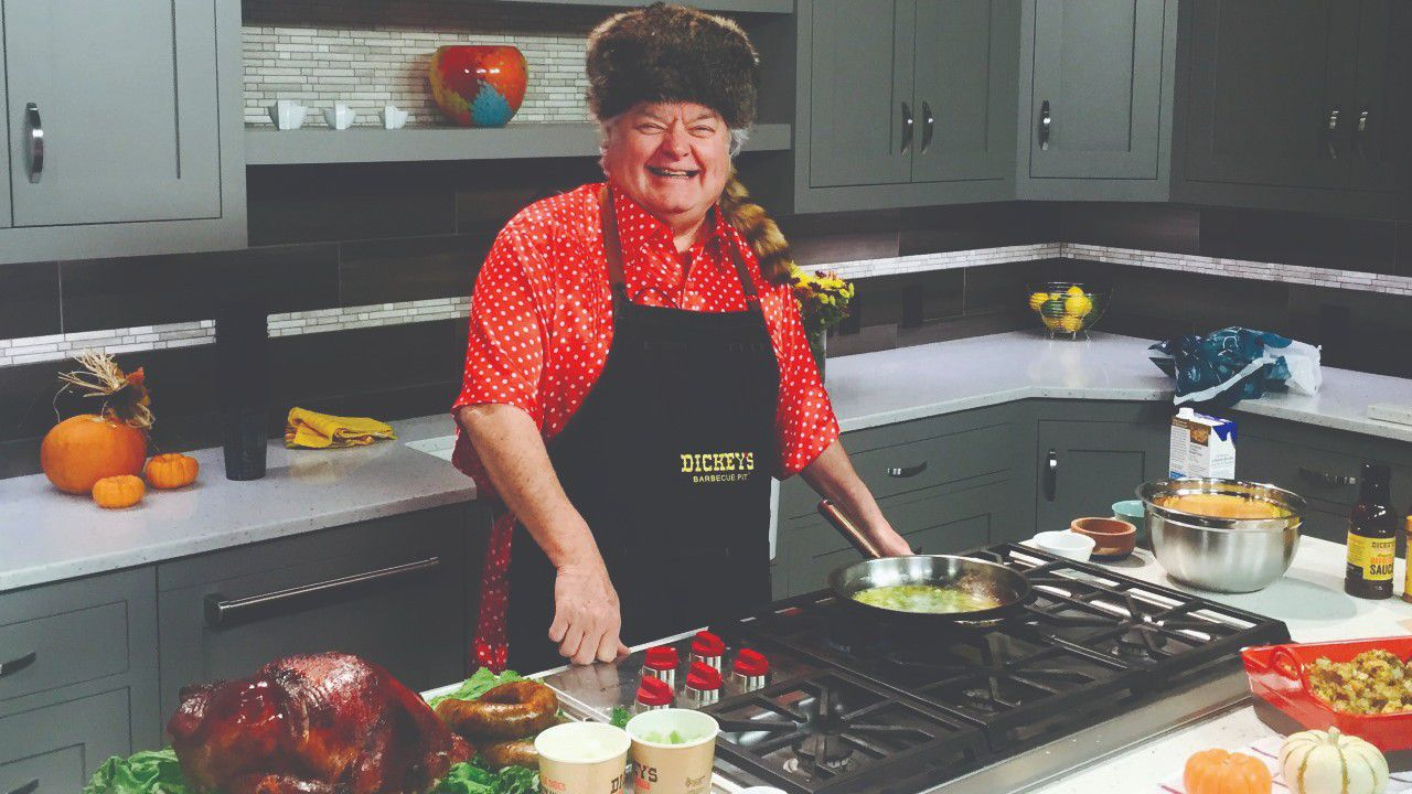 Mr. Dickey —in his beloved hat — doing one of his famous food demonstrations for a local television station.