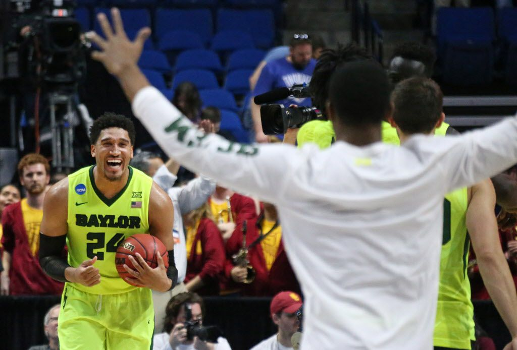Baylor Bears guard Ishmail Wainright (24) celebrates with teammates as time winds down in the second half of the bears' win over the Trojans during the USC Trojans vs. the Baylor Bears NCAA men's basketball game at the BOK Center in Tulsa, Oklahoma on Sunday, March 19, 2017. (Louis DeLuca/The Dallas Morning News)