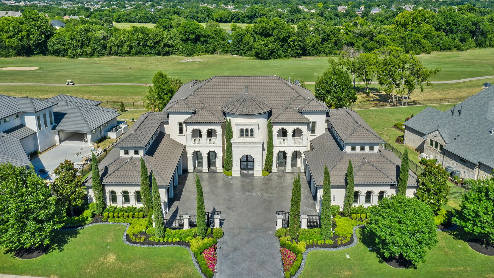 Located in a gated community, the estate at 414 Lakeway Drive in Allen offers golf course views and luxury amenities inside and outside. It is priced at $2,850,000.