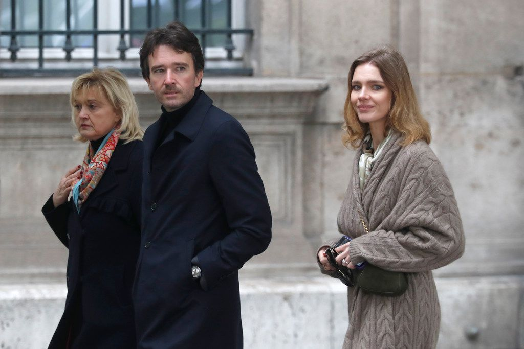 "Antoine Arnault, son of LVMH president Bernard Arnault, and his wife Natalia Vodianova, right, arrive at the damaged Notre Dame cathedral after the fire in Paris, Tuesday, April 16, 2019. French big French companies Total and L'Oreal are pledging to donate 200 million euros to support the reconstruction of Notre Dame cathedral. A few hours after billionaires tycoons Bernard Arnault and Francois Pinault announced they would give a total of 300 millions, oil and gas giant Total said the firm would contribute 100 million euros ""to help the reconstruction of this architectural jewel."" L'Oreal promised the same amount of money to rebuild ""a symbol of French heritage and of our common history."" Among other contributors, Bouygues construction group CEO Martin Bouygues said he and his brother Olivier would donate 10 millions. (AP Photo/Thibault Camus)"