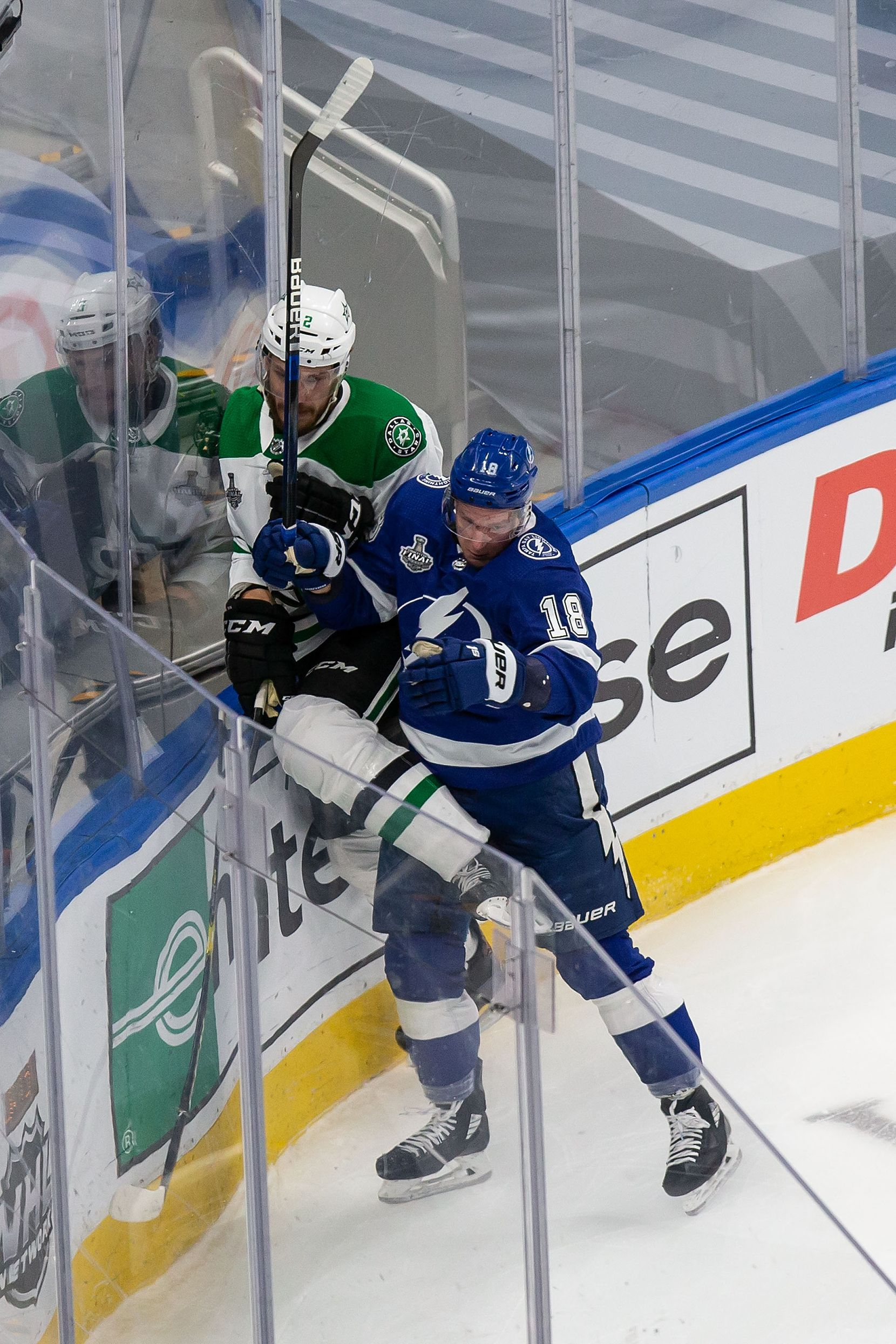 Jamie Oleksiak (2) of the Dallas Stars is hit by Ondrej Palat (18) of the Tampa Bay Lightning during Game Two of the Stanley Cup Final at Rogers Place in Edmonton, Alberta, Canada on Monday, September 21, 2020. (Codie McLachlan/Special Contributor)