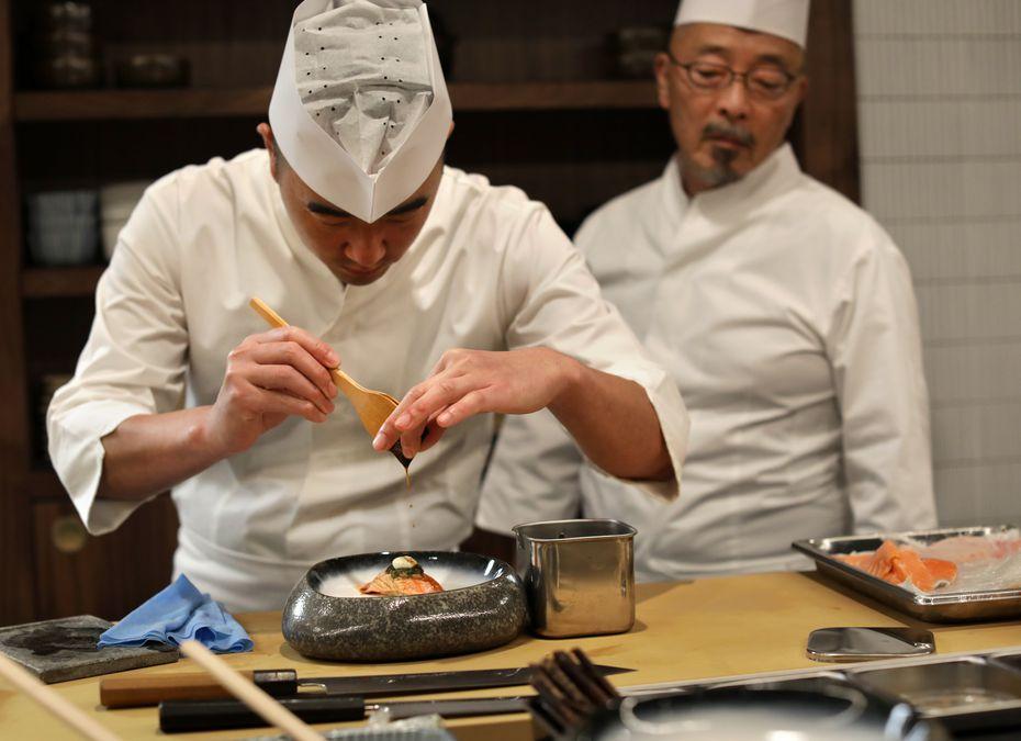 Found and chef Jimmy Park, left, and executive chef Shinichiro Kondo prepare a salmon belly dish at Shoyo in Dallas.