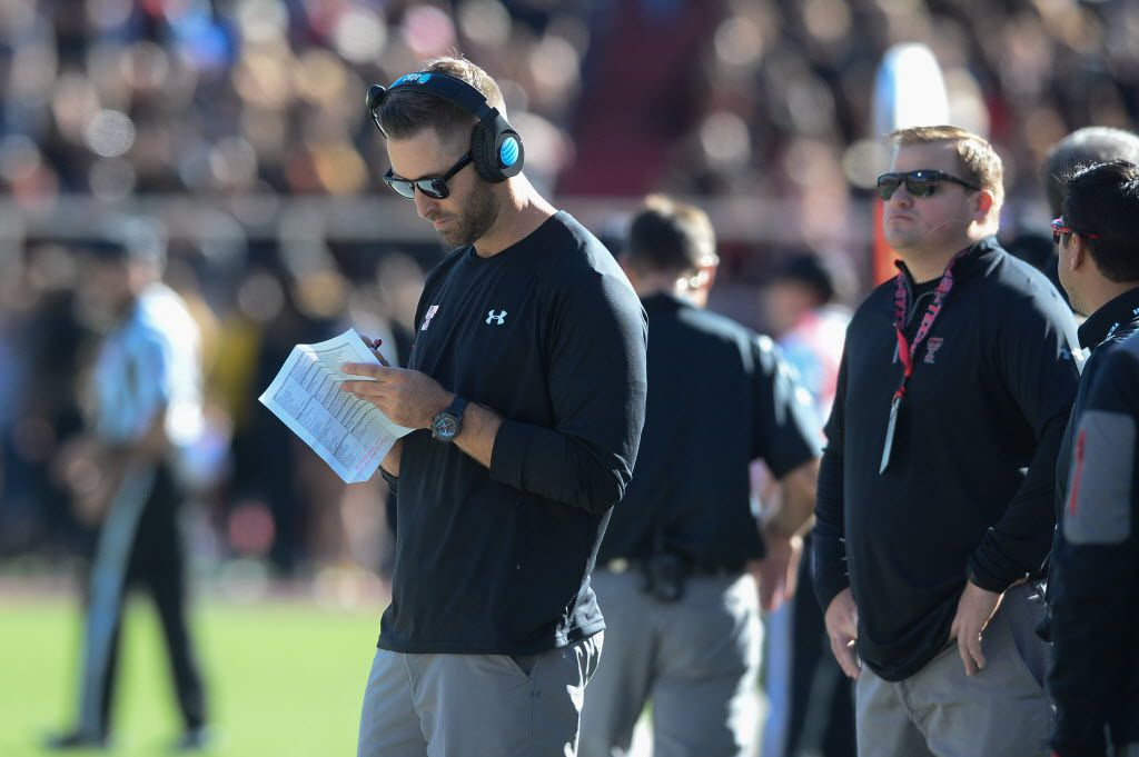 LUBBOCK, TX - OCTOBER 31: Head coach Kliff Kingsbury of the Texas Tech Red Raiders takes notes during the game against the Oklahoma State Cowboys on October 31, 2015 at Jones AT&T Stadium in Lubbock, Texas. Oklahoma State defeated Texas Tech 70-53. (Photo by John Weast/Getty Images)