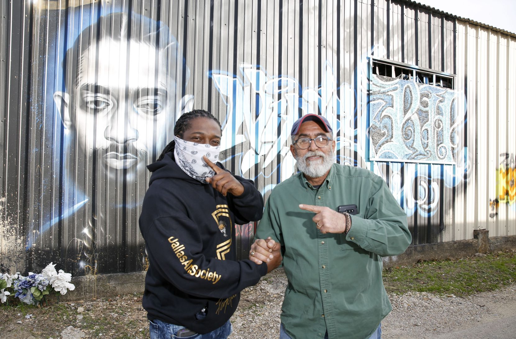 Theo Ponchaveli (left) and Auto Exports Owner Massoud Nasseri stand in front of Ponchaveli's homage to slain rapper Nipsey Hussle on the side of Auto Exports' building in West Dallas on Dec. 6, 2019.