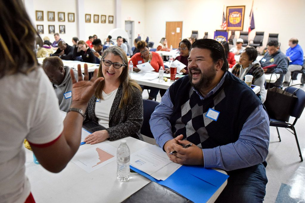 Volunteer Pam Thompson (left) and candidate Dan Barrios, both of Richardson, speak with an educator during a candidate workshop conducted by the Texas Working Families Party. The workshop helps aspiring minority candidates to run for office.