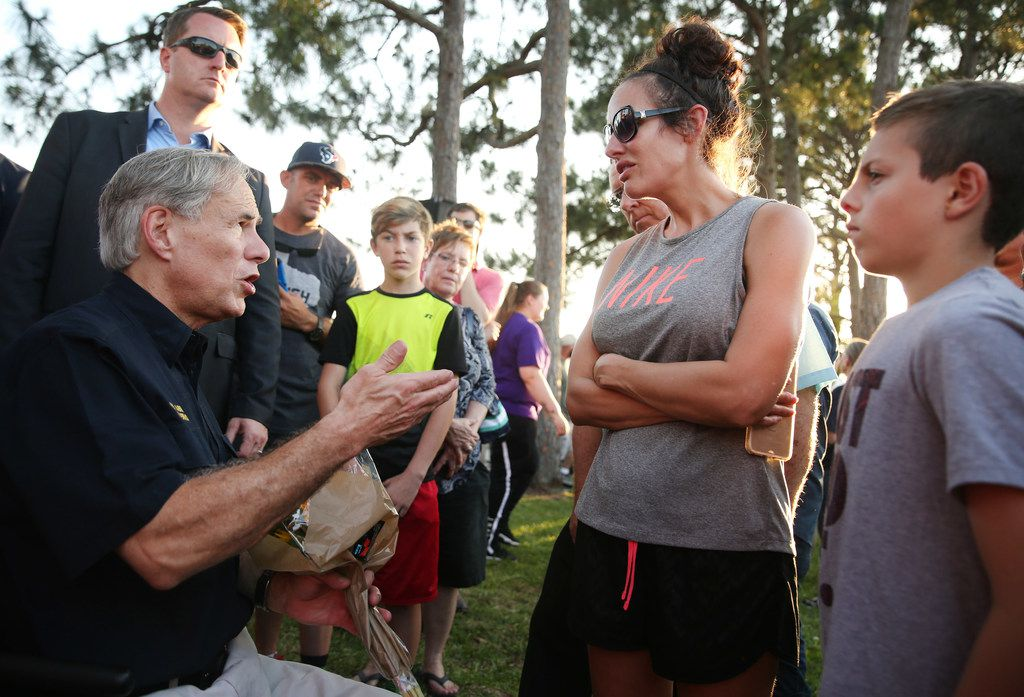 During a vigil Friday, Gov. Greg Abbott spoke with Jamie Martin, whose daughter, Bailey Click, 16, attends Santa Fe High School. Martin, when asked by Abbott what can be done to prevent school shootings, suggested better security.