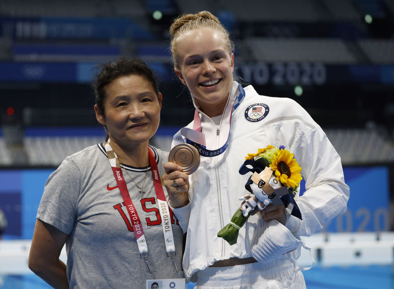 USA's diving coach Jianli You and Krysta Palmer pose for photographers after competing in the women's 3 meter springboard final during the postponed 2020 Tokyo Olympics at Tokyo Aquatics Centre, on Sunday, August 1, 2021, in Tokyo, Japan. Palmer finished 3rd with a total score of 343.75 to earn a bronze medal. (Vernon Bryant/The Dallas Morning News)