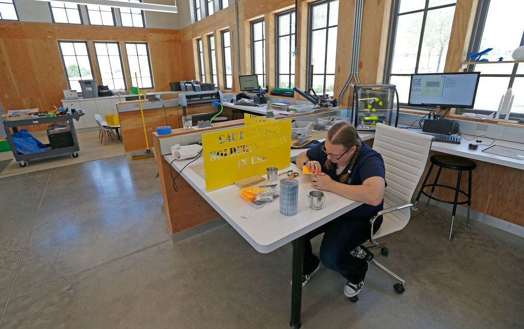 Danielle Webber works on a project inside the Walsh Makerspace in the Walsh development in Fort Worth, Texas, Thursday, July 5, 2018. The Walsh development, formerly part of Walsh Ranch, is on more than 7,000 acres. (Jae S. Lee/The Dallas Morning News)
