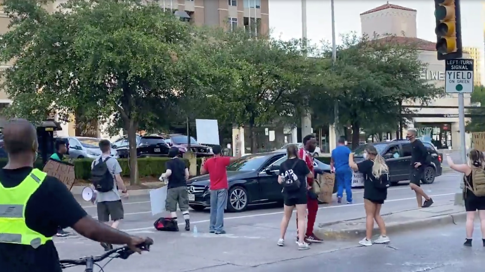 This still image from a video provided by Jordan Smith shows an encounter between protesters and a man who reportedly had a gun at the intersection of North Pearl Street and McKinney Avenue.