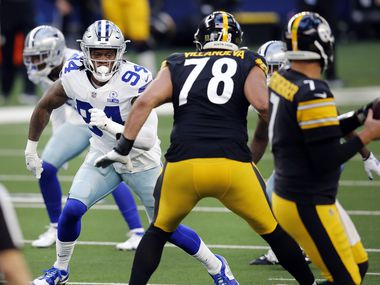 Dallas Cowboys defensive end Randy Gregory (94) pass rushes Pittsburgh Steelers quarterback Ben Roethlisberger (7) during the first quarter at AT&T Stadium in Arlington, Texas Sunday, November 8, 2020.