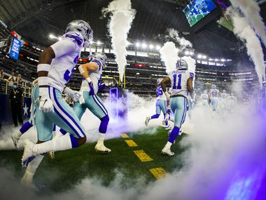Dallas Cowboys linebacker Micah Parsons (11) takes the field along with cornerback Israel Mukuamu (left) before a preseason NFL football game against the Houston Texans at AT&T Stadium on Saturday, Aug. 21, 2021, in Arlington.