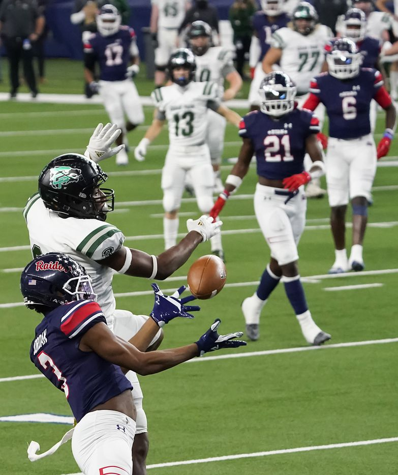 Denton Ryan Austin Jordan (3) nearly intercepts a pass intended for Cedar Park wide receiver Josh Cameron (34) during the first half of the Class 5A Division I state football championship game at AT&T Stadium on Friday, Jan. 15, 2021, in Arlington, Texas. (Smiley N. Pool/The Dallas Morning News)