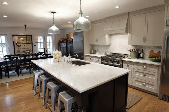 Munsterman uses white marble generously in the kitchen and baths.