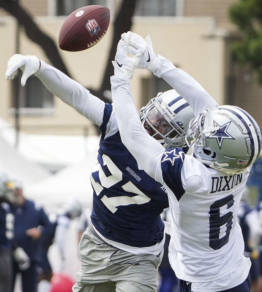Dallas Cowboys cornerback Trevon Diggs (27) breaks up a pass intended for wide receiver Johnnie Dixon (6) during a practice at training camp on Sunday, July 25, 2021, in Oxnard, Calif.