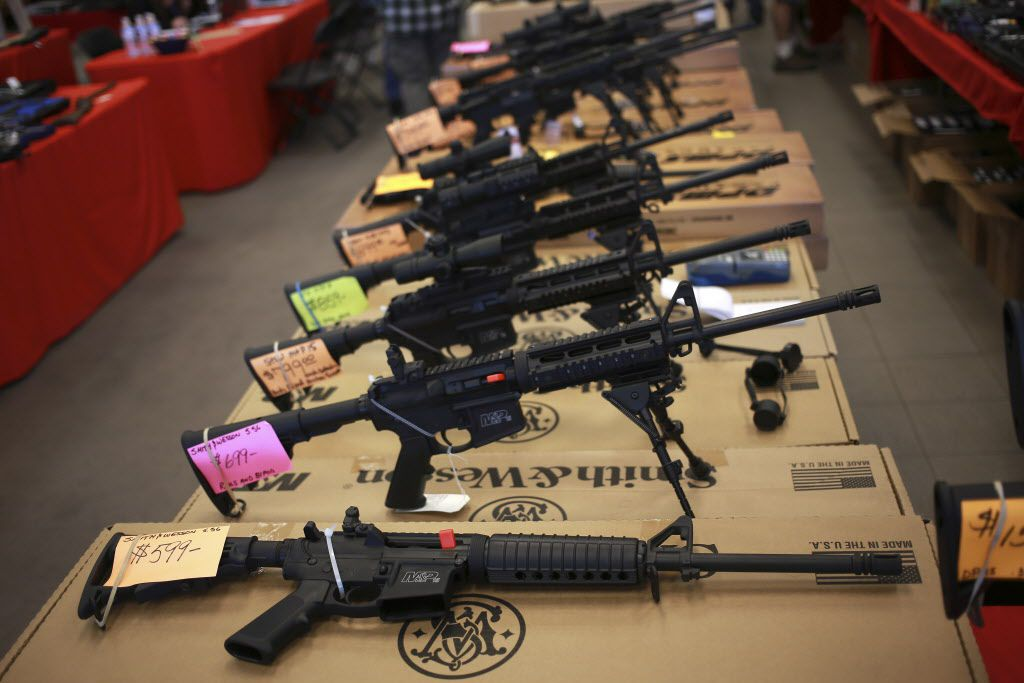 Smith & Wesson AR-15 rifles for sale at a gun show in Loveland, Colo., in 2014. (Luke Sharrett/The New York Times)