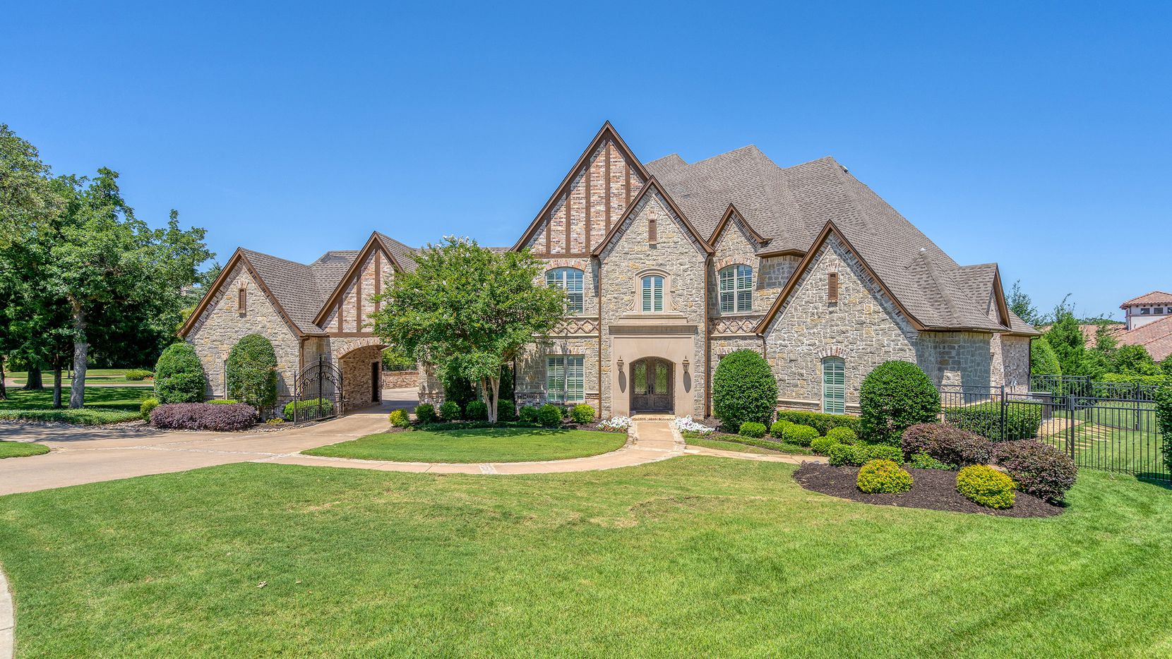 The 1-acre property at 1257 Biltmore Drive in Southlake's Westwyck Hills features a recently renovated kitchen and a new price of $2,149,000.