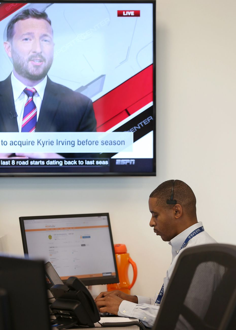 Darnell Cain, a digital sales manager at Blue Star Sports, works at the company's office at The Star in Frisco, Texas on Tuesday, Aug. 8, 2017.