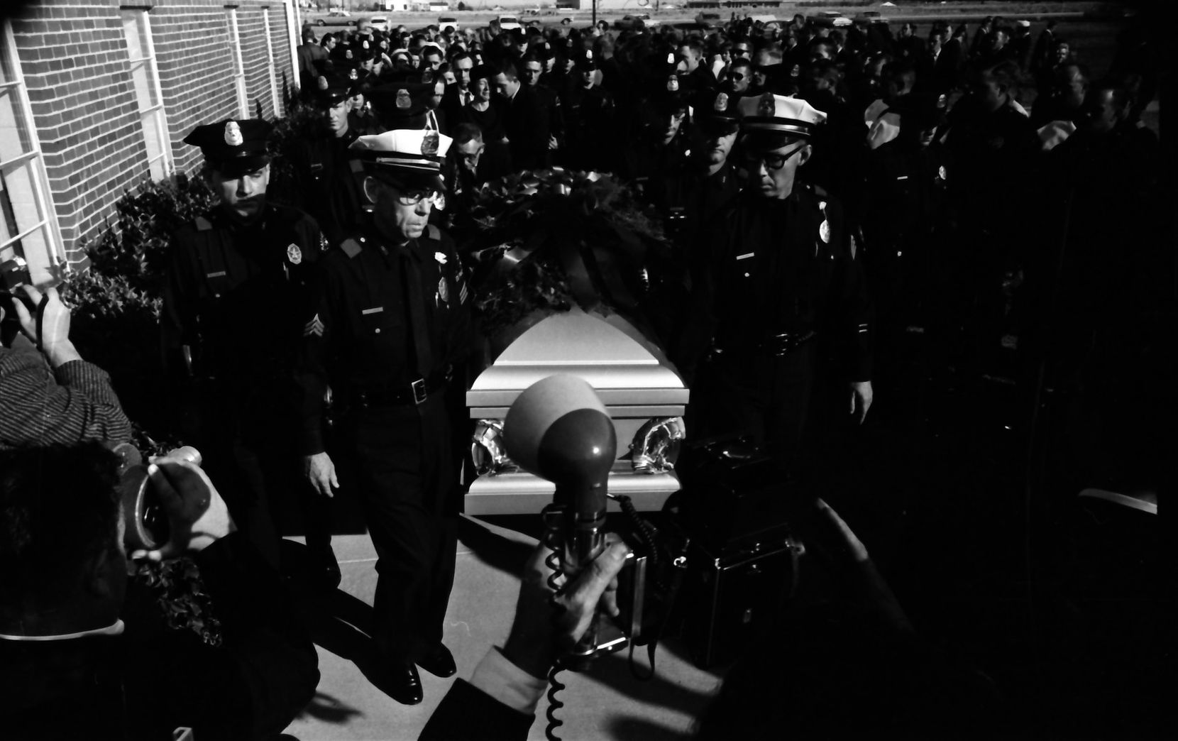 Officers held J.D. Tippit's casket at his funeral in 1963.