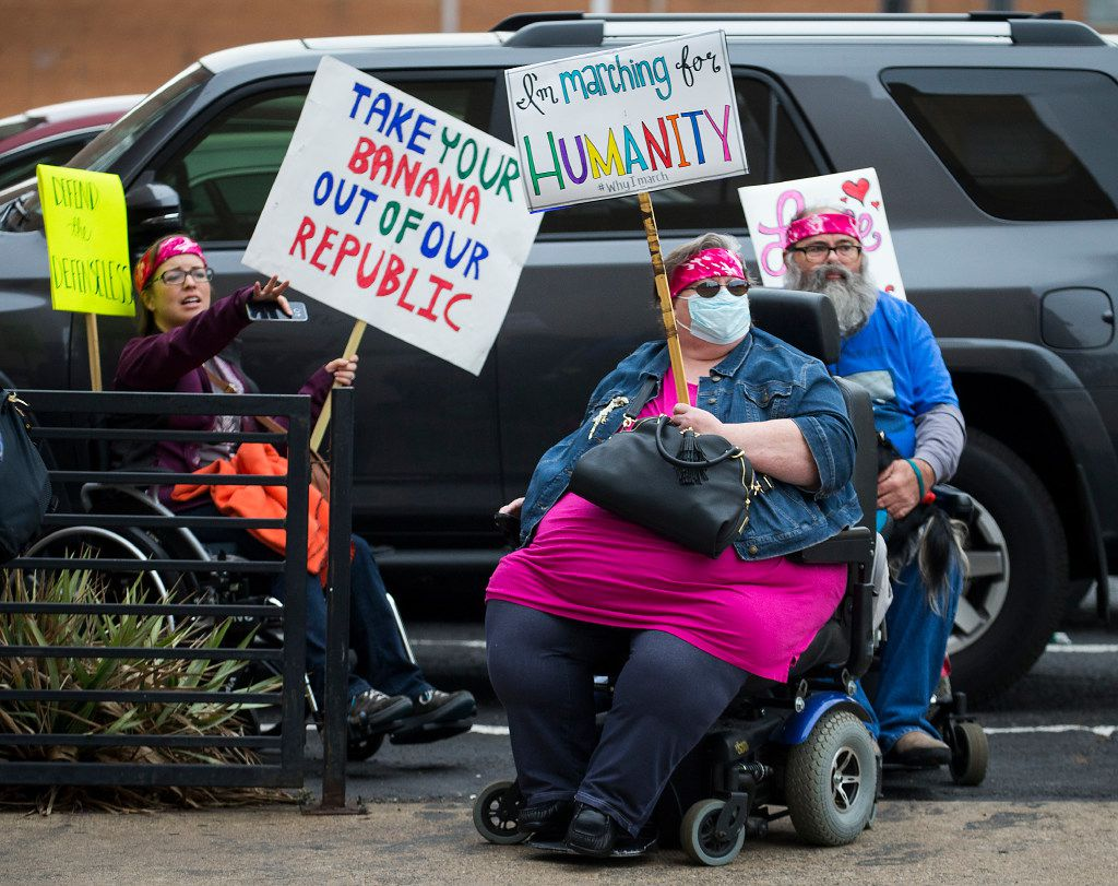 Many demonstrators came equipped with signs Saturday at the Women's March in Dallas.