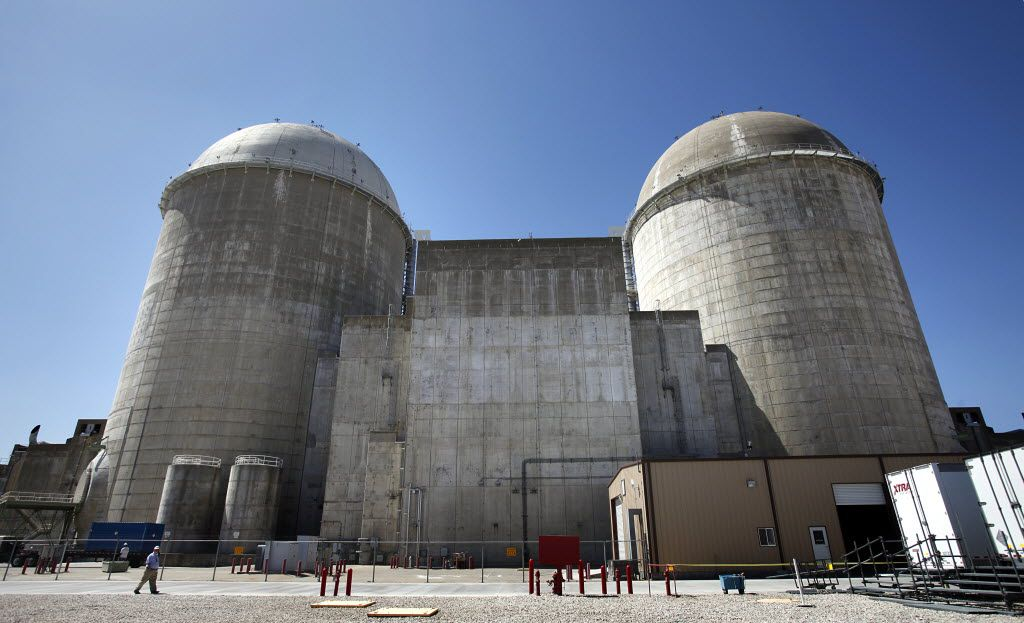 Luminant's Comanche Peak Nuclear Power Plant's domed Unit 1 reactor, left, and Unit 2 reactor , right, bookend the fuel building which houses spent fuel rods, center, at the plant near Glen Rose, Texas, Wednesday, March 23, 2011. (Tom Fox/The Dallas Morning News)