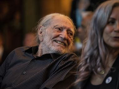 Willie Nelson laughs after arriving at The Texas Tribune Festival on Sept. 28, 2019 in Austin, Texas.