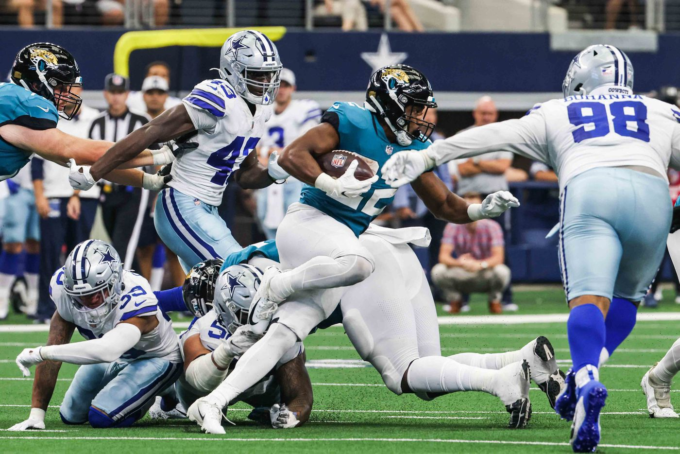Jacksonville Jaguars running back Devine Ozigbo, 22, runs with the football during a preseason game at AT&T stadium in Arlington on Sunday, August 29, 2021. (Lola Gomez/The Dallas Morning News)