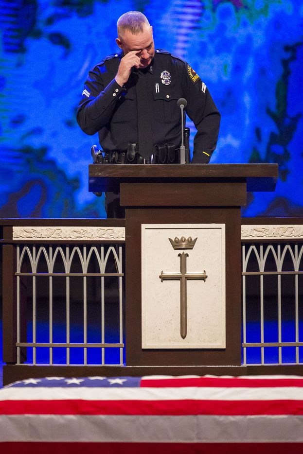Dallas police officer Eddie Coffey wipes a tear while speaking during funeral services for Dallas police Sr. Cpl. Lorne Ahrens at Prestonwood Baptist Churchon Wednesday, July 13, 2016, in Plano.