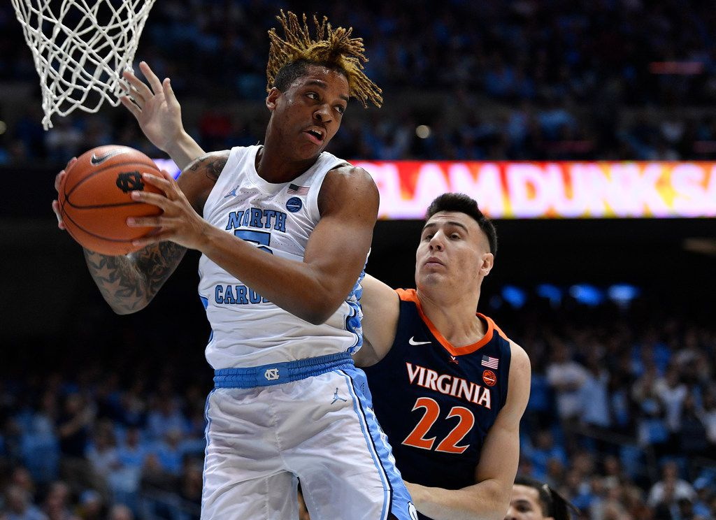 CHAPEL HILL, NORTH CAROLINA - FEBRUARY 15: Armando Bacot #5 of the North Carolina Tar Heels battles Francisco Caffaro #22 of the Virginia Cavaliers for a rebound during the first half of their game at the Dean Smith Center on February 15, 2020 in Chapel Hill, North Carolina. (Photo by Grant Halverson/Getty Images)