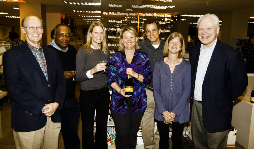 Keven Ann Willey (center) led a team that won the 2010 Pulitzer Prize for Editorial Writing for its relentless work in exploring the stark social and economic disparity between the city's better-off northern half and distressed southern half. Flanking her from left are William McKenzie, Jim C. Mitchell Jr., Colleen McCain Nelson, Tod Robberson, Sharon Grigsby and Robert W. Mong Jr. (Andy Jacobsohn/The Dallas Morning News)